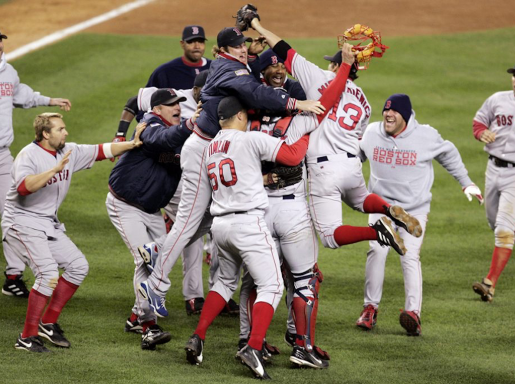 The Boston Red Sox celebrate after defeating the New York Yankees 10-3 in game 7 of the ALCS Wednesday, Oct. 20, 2004 in New York. (AP Photo/Amy Sancetta)